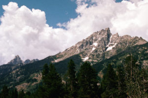 The jagged peaks of the Teton range reaching into the sky.